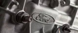 close up of Ford logo on engine