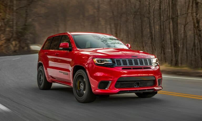 19 Jeep GrandCherokee Exterior driving on highway throughout Forest
