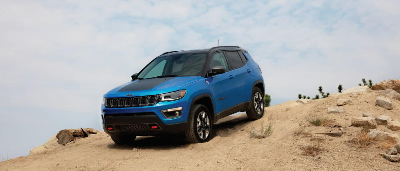 2019 Jeep Compass on dirt path