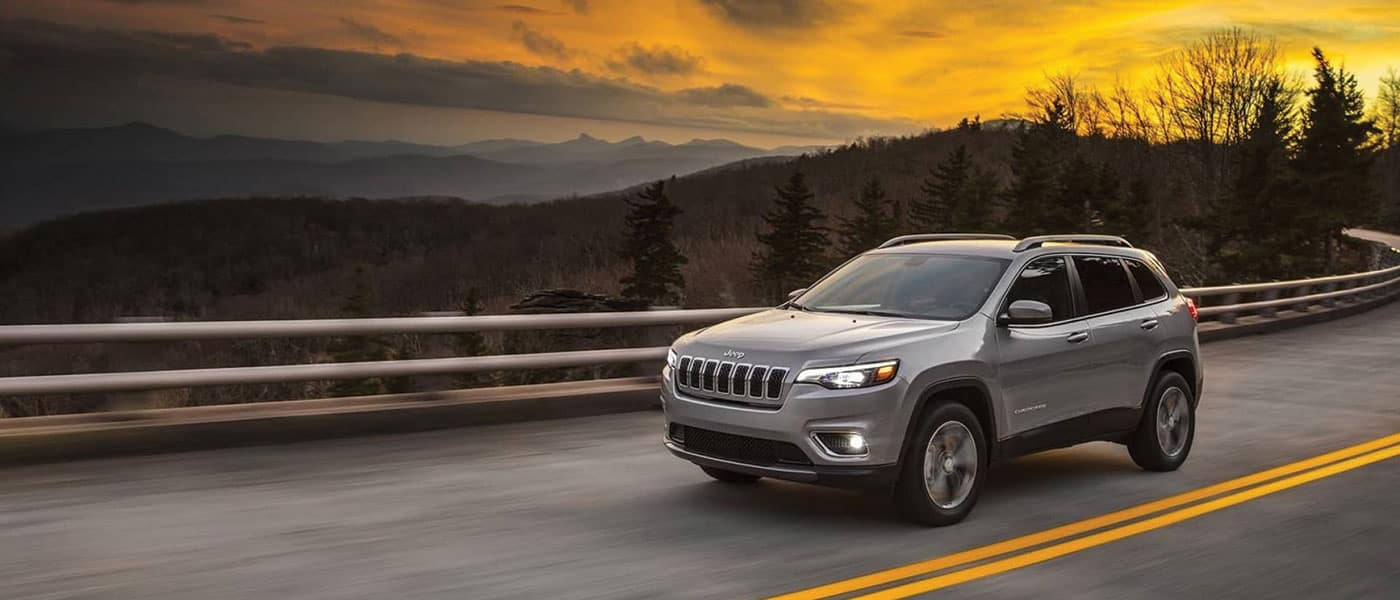 2019 Jeep Cherokee driving down street
