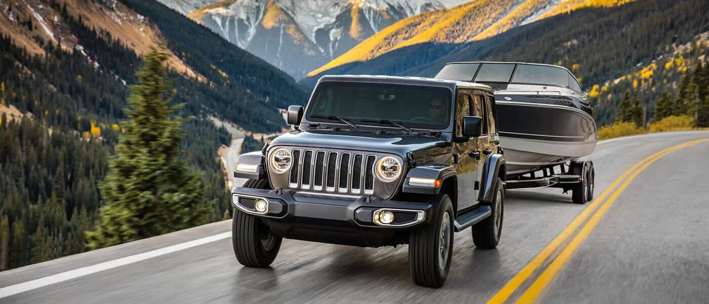 Grey 2019 Jeep Wrangler towing boat