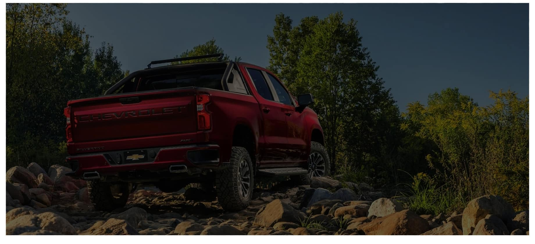 a chevy truck parked on rocks