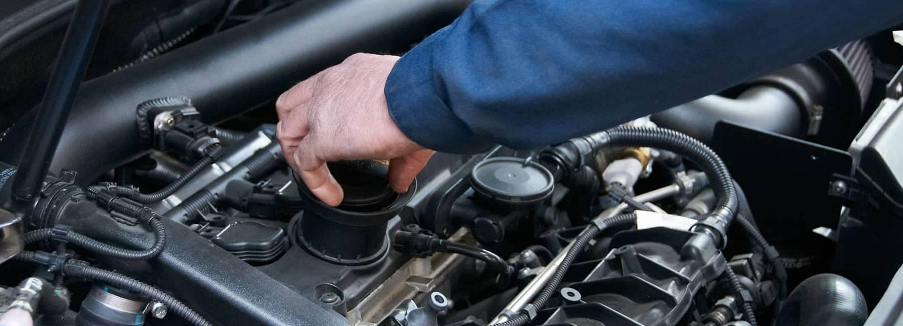 service technician working on engine