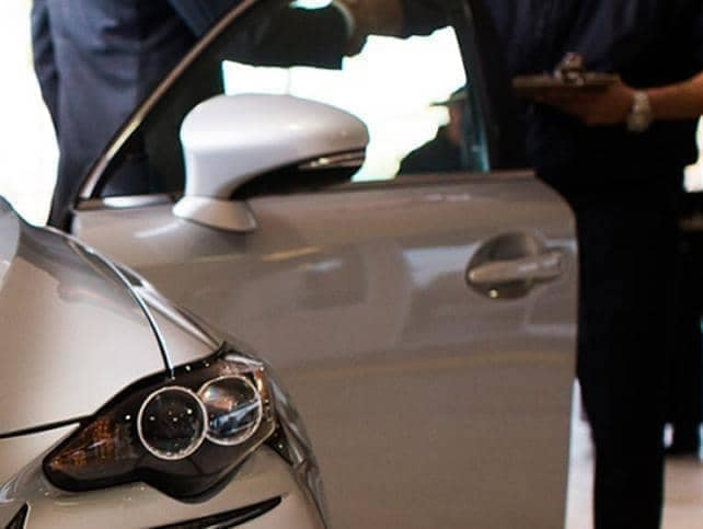 A Lexus service rep shaking hands with a client.