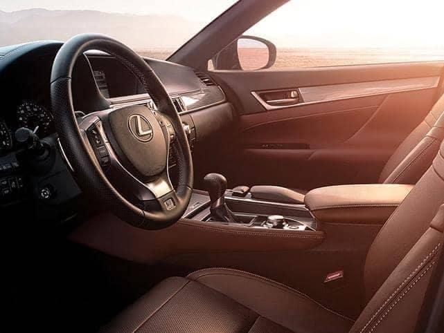 The steering wheel of a Lexus vehicle.