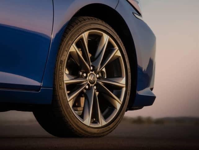A tire on a blue Lexus.
