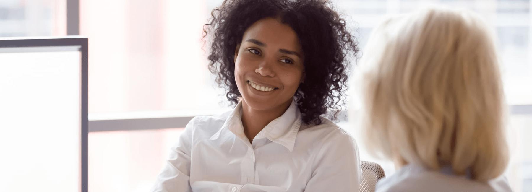 smiling customer meets with finance advisor