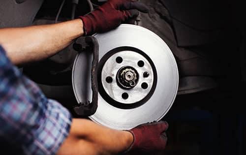 Technician putting brakes on