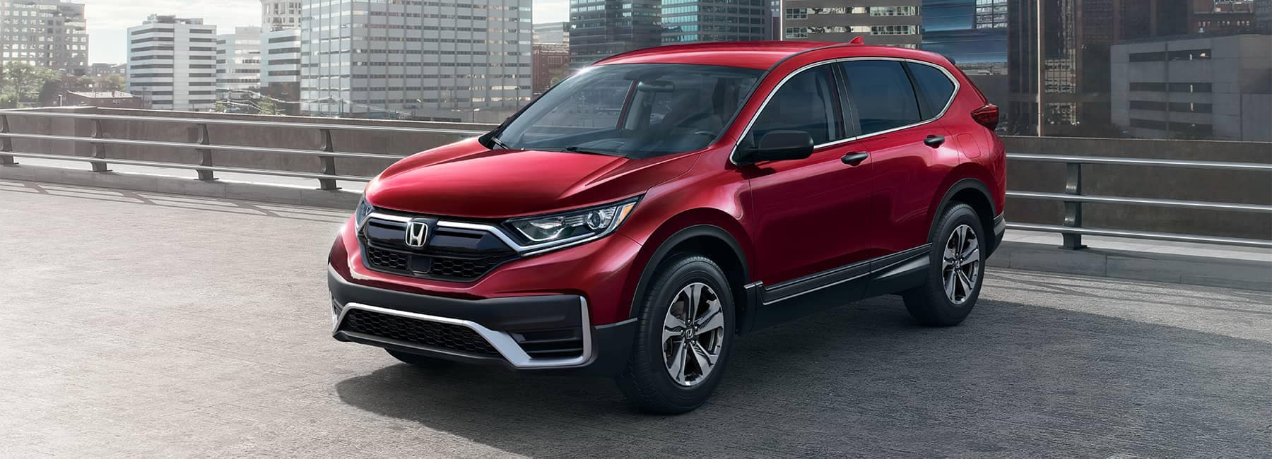 2021 Red Honda CR-V parked on the roof of a parking garage