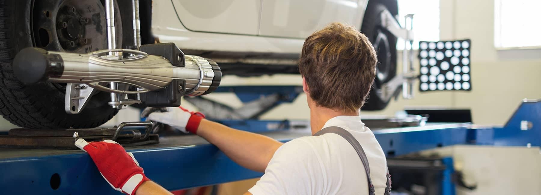 Mechanic doing an alignment