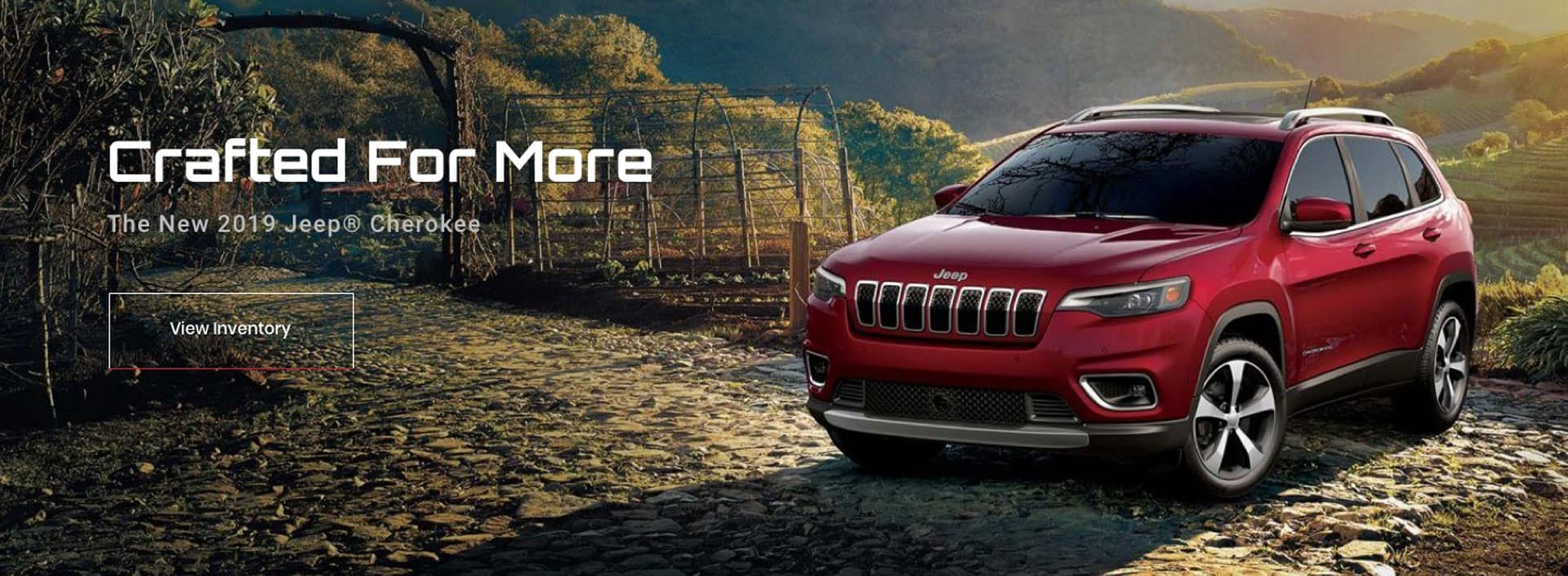 Crafted For More The New 2019 Jeep Cherokee View Inventory Slider of Red Front/Side view of a Cherokee model