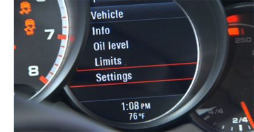 """How do I adjust the clock in my Porsche - Step 3 - In dash display of a Porsche, """"Settings"""" highlighted"""