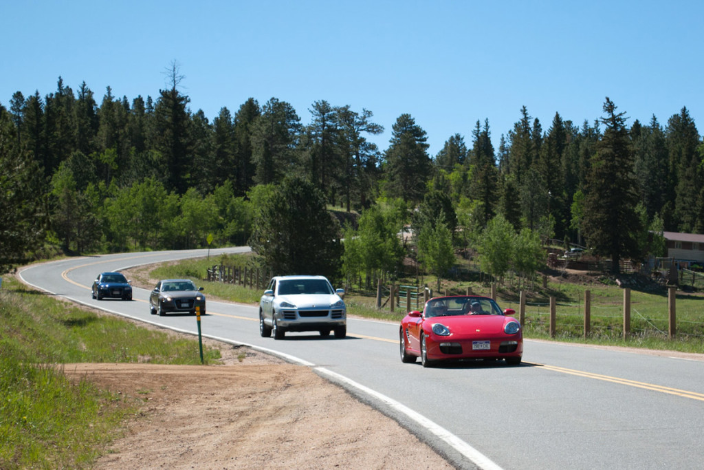 A line of beuatiful cars on a winding road - Prestige Imports Mountain Tour 2012