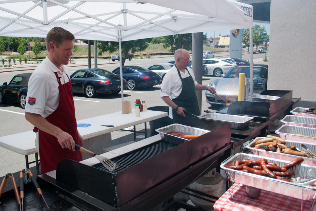 Prestige Imports GM Justin Adis mans the grill during Prestige Imports 2012 Mountain Tour barbecue
