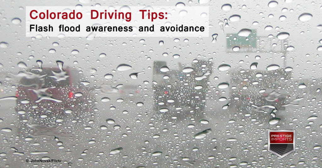 View of a busy highway through a rainy windshield. Photo used to illustrate an article on Colorado Driving Tips - flash flood awareness and avoidance.