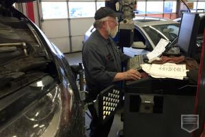 Layne Burke, Audi Technician, completes an alignment