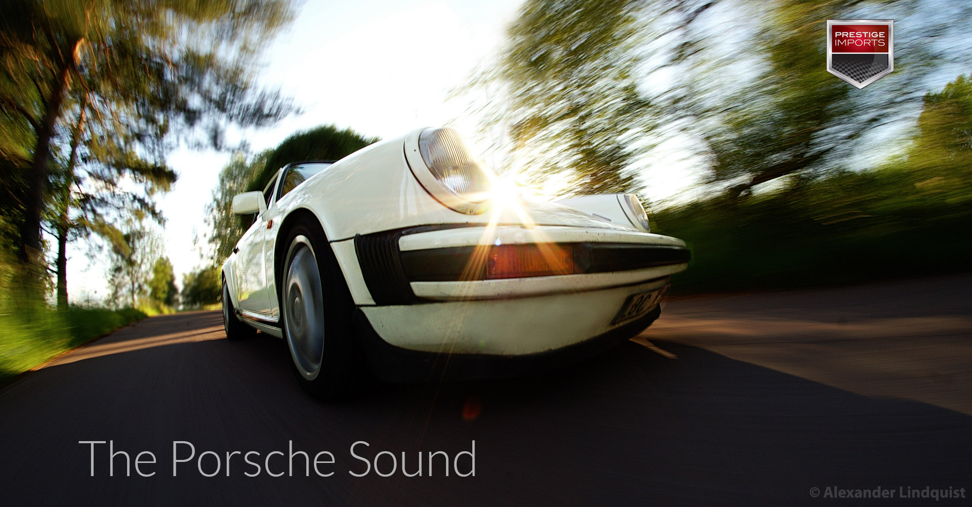 The Porsche Sound - Low angle view of a classic Porsche driving on a country road.