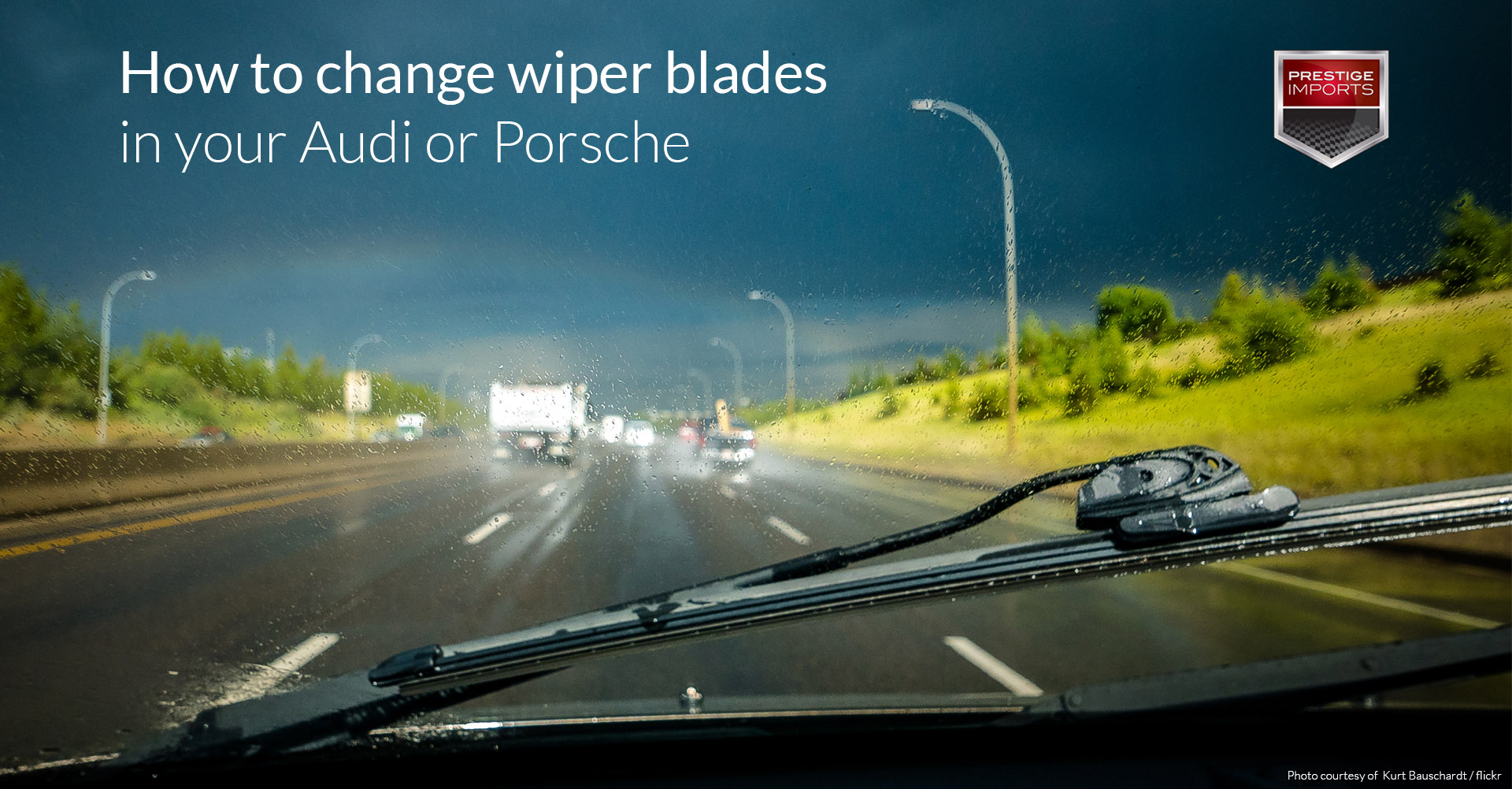 Windshield wiper blade and rainy windshield with busy highway in the background. Used to illustrate the article - How to change wiper blades in your Audi or Porsche