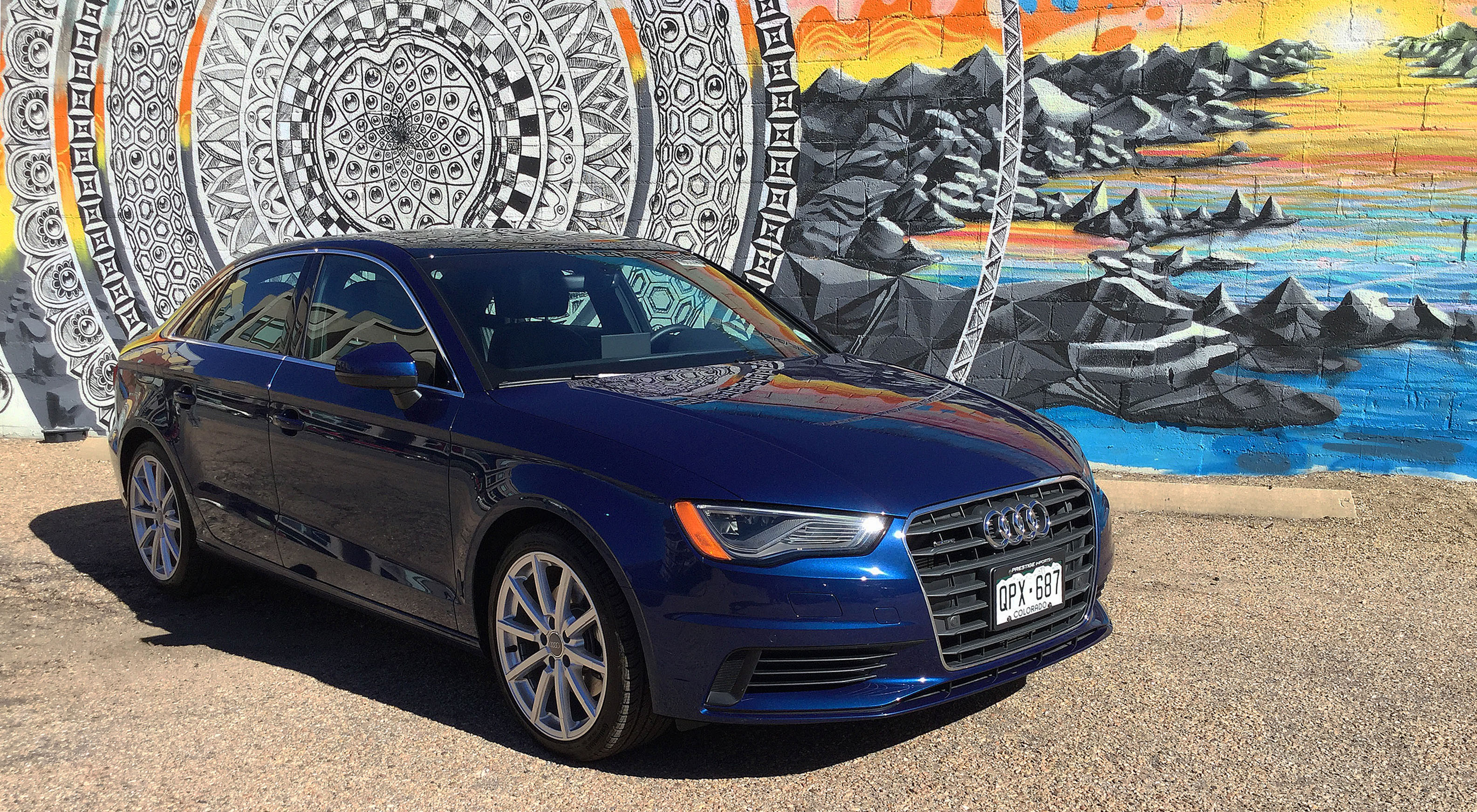 The Audi A3 in front of an interesting mural in Denver's RiNo Art District.