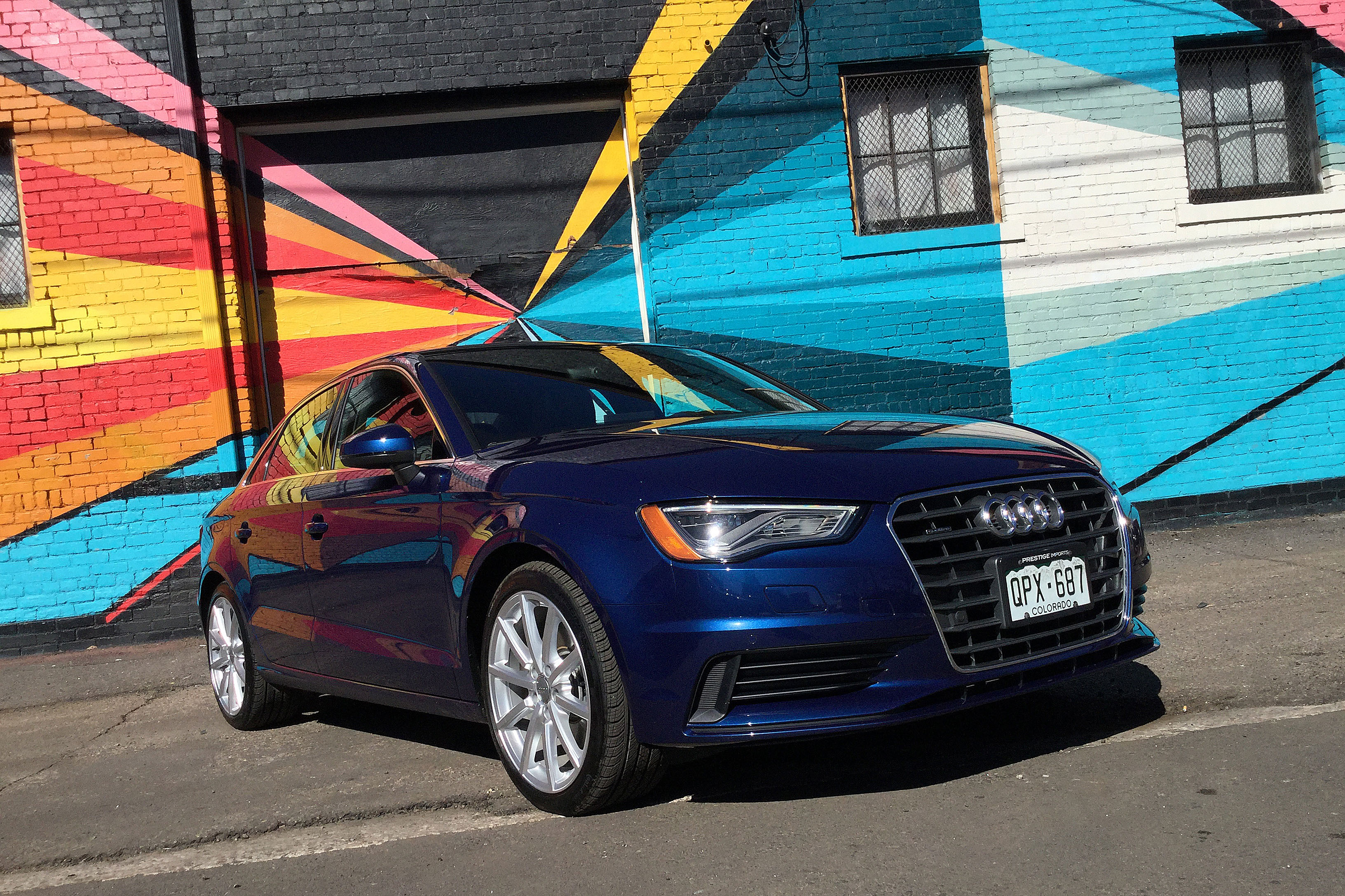 The Audi A3 in front of a colorful mural in Denver's RiNo Art District.