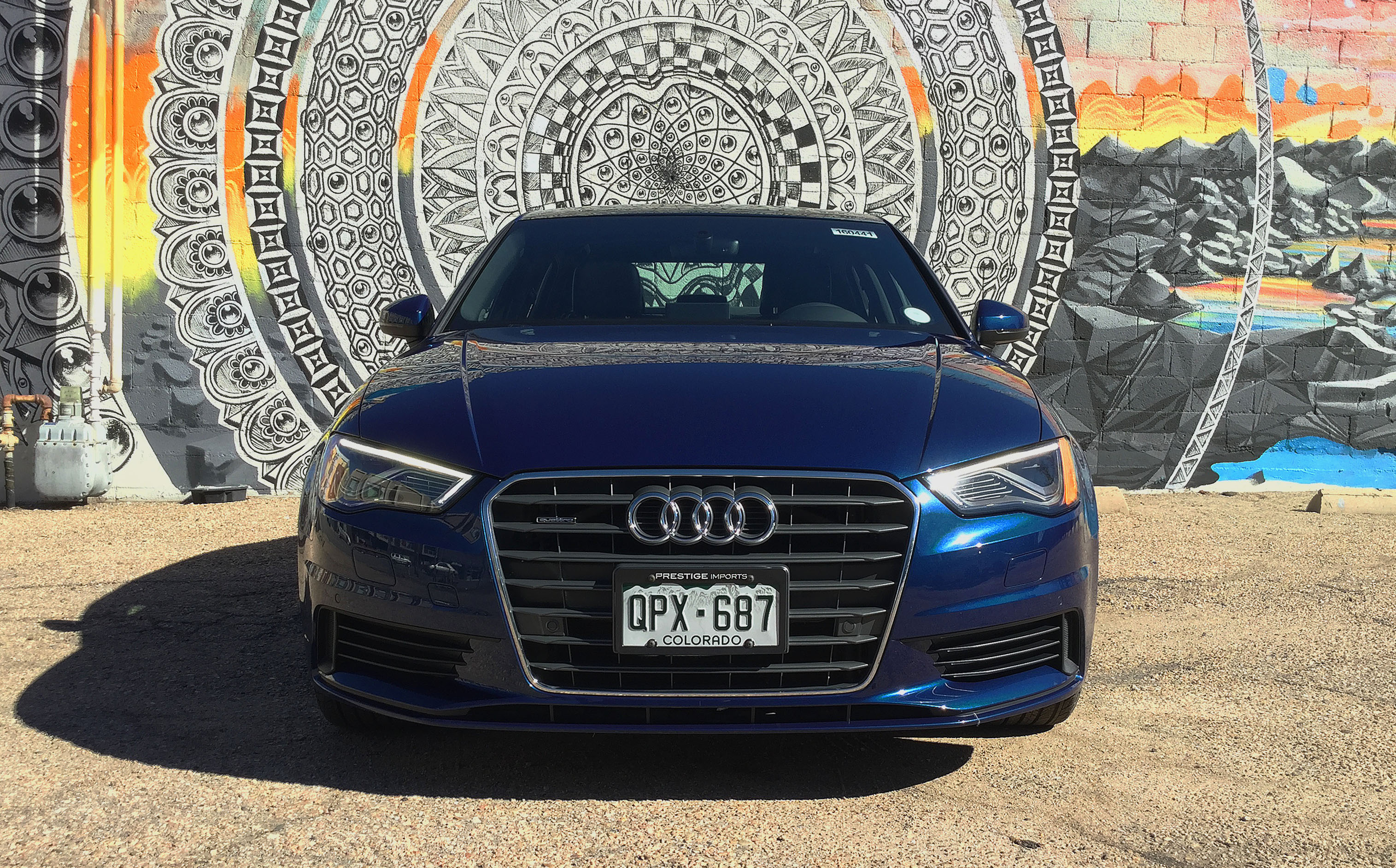The Audi A3 in front of a mesmerizing mural in Denver's RiNo Art District.