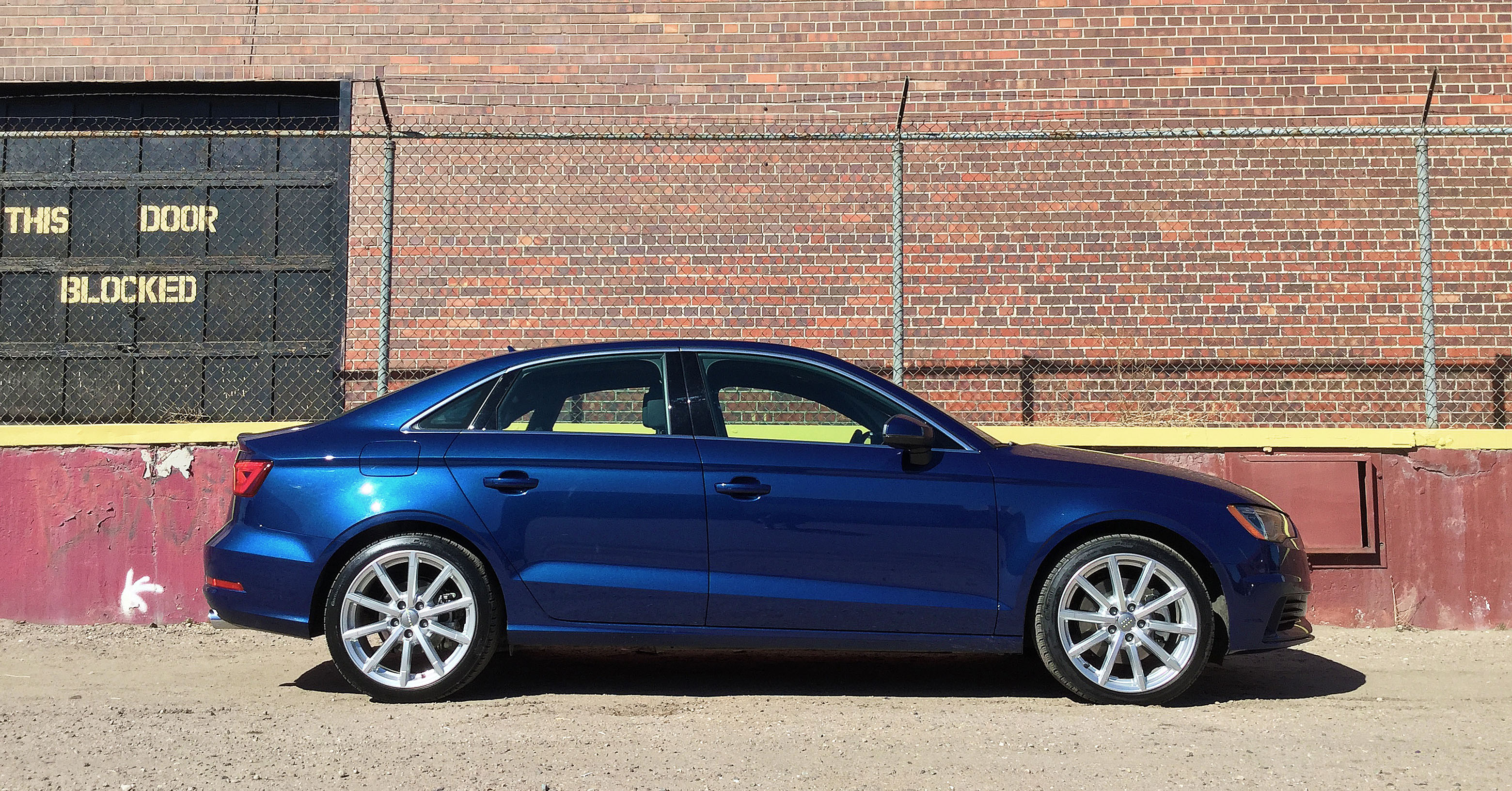 The Audi A3 in front of a warehouse in Denver's RiNo Art District.