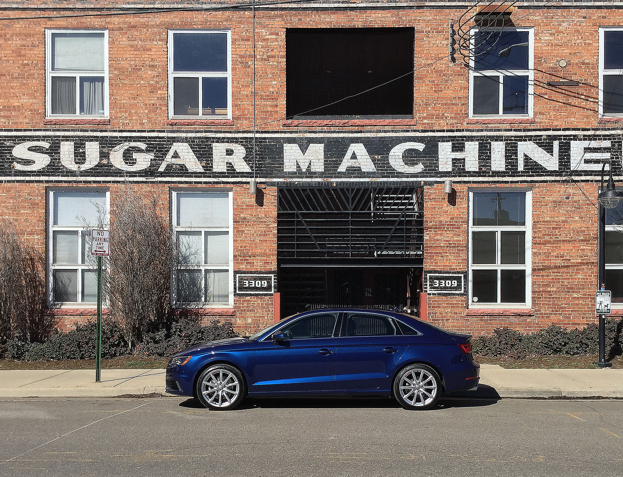 The Audi A3 in front of a building entrance in Denver's RiNo Art District.