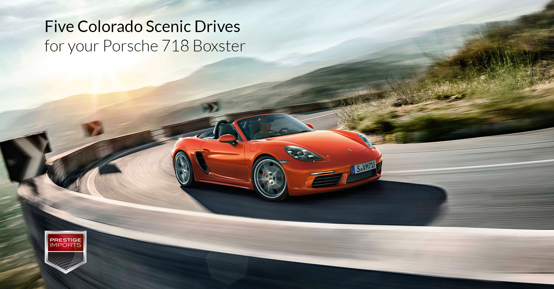 "Photo of a Porsche 718 Boxster on a mountain road. Used to illustrate the article ""Five Colorado Scenic Drives for your Porsche 718 Boxster""."