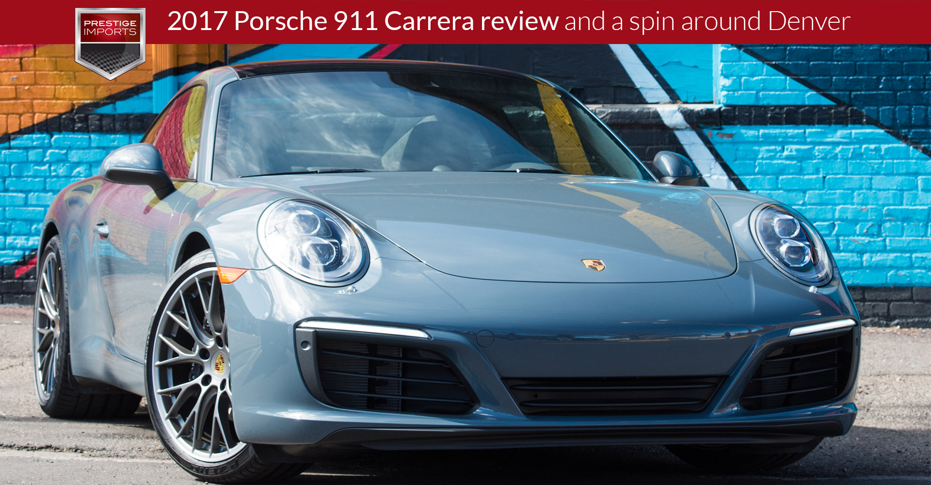 A new 2017 Porsche 911 Carrera parked in front of a colorful mural in Denver, CO.