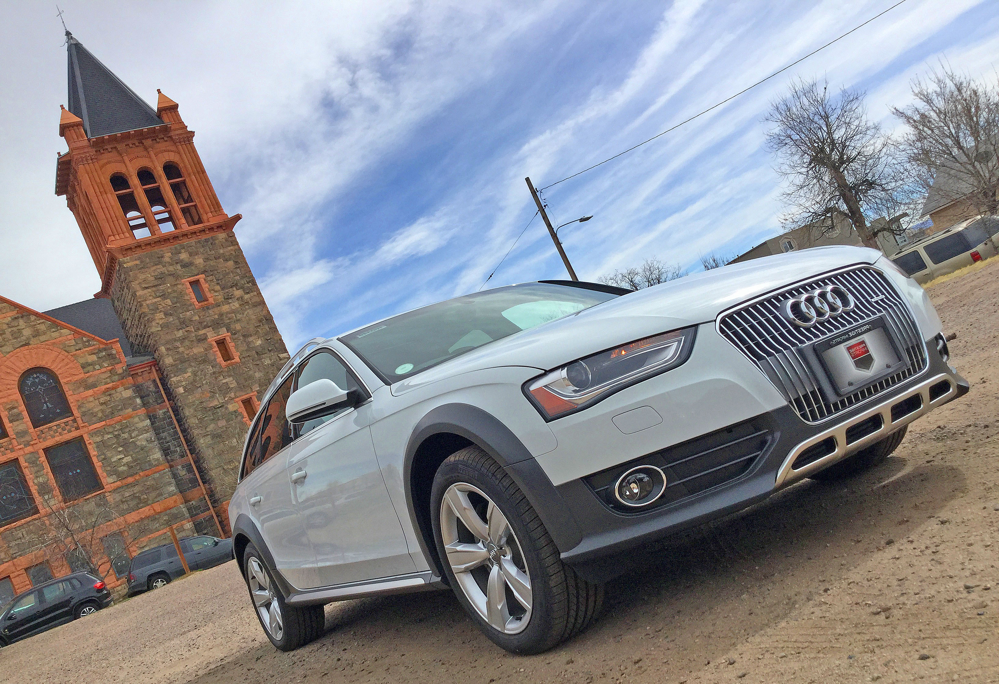 An Audi allroad sits in front of a church in the Denver Highlands neighborhood