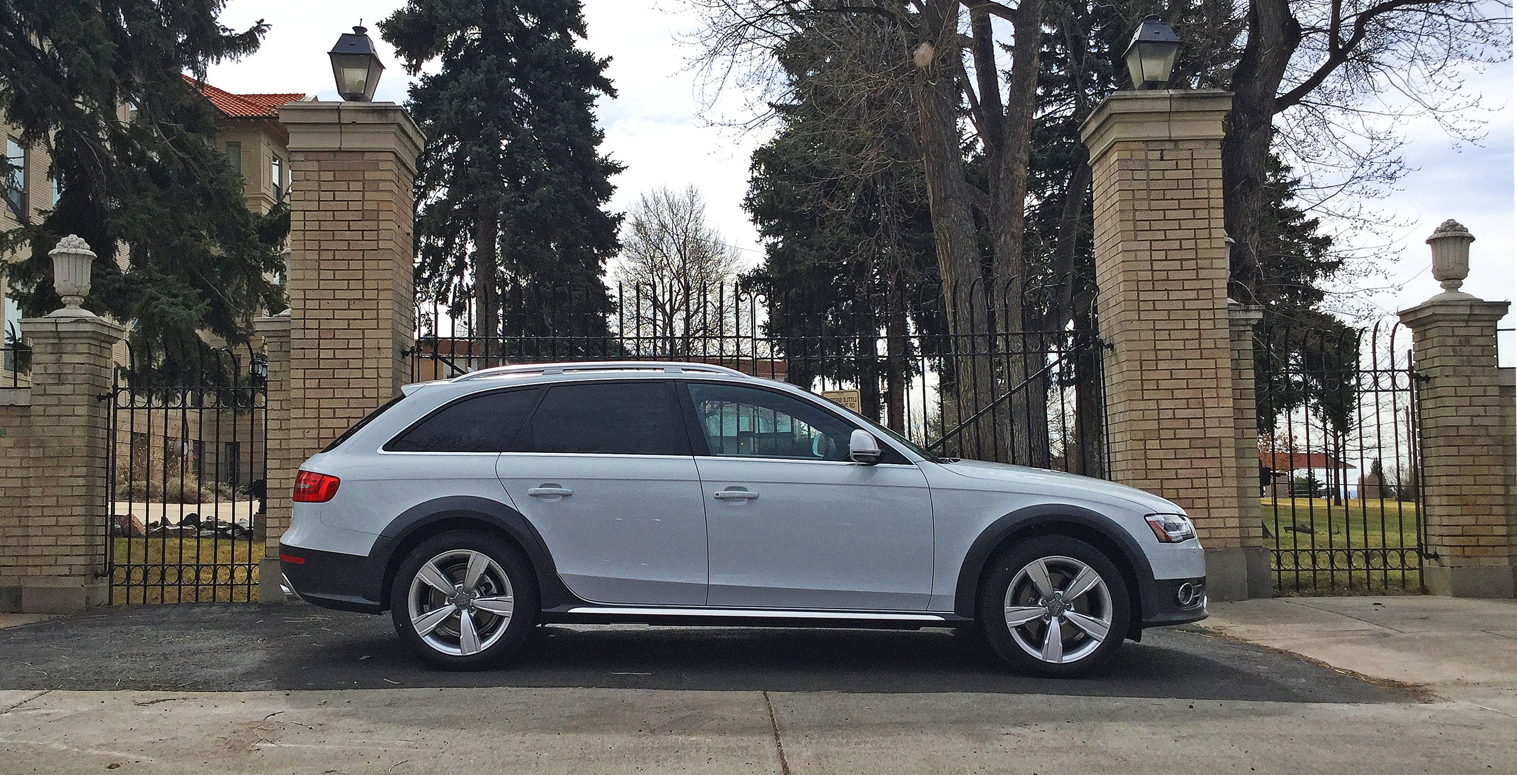 An Audi allroad parked in front of a gate in the Highland, Denver, CO