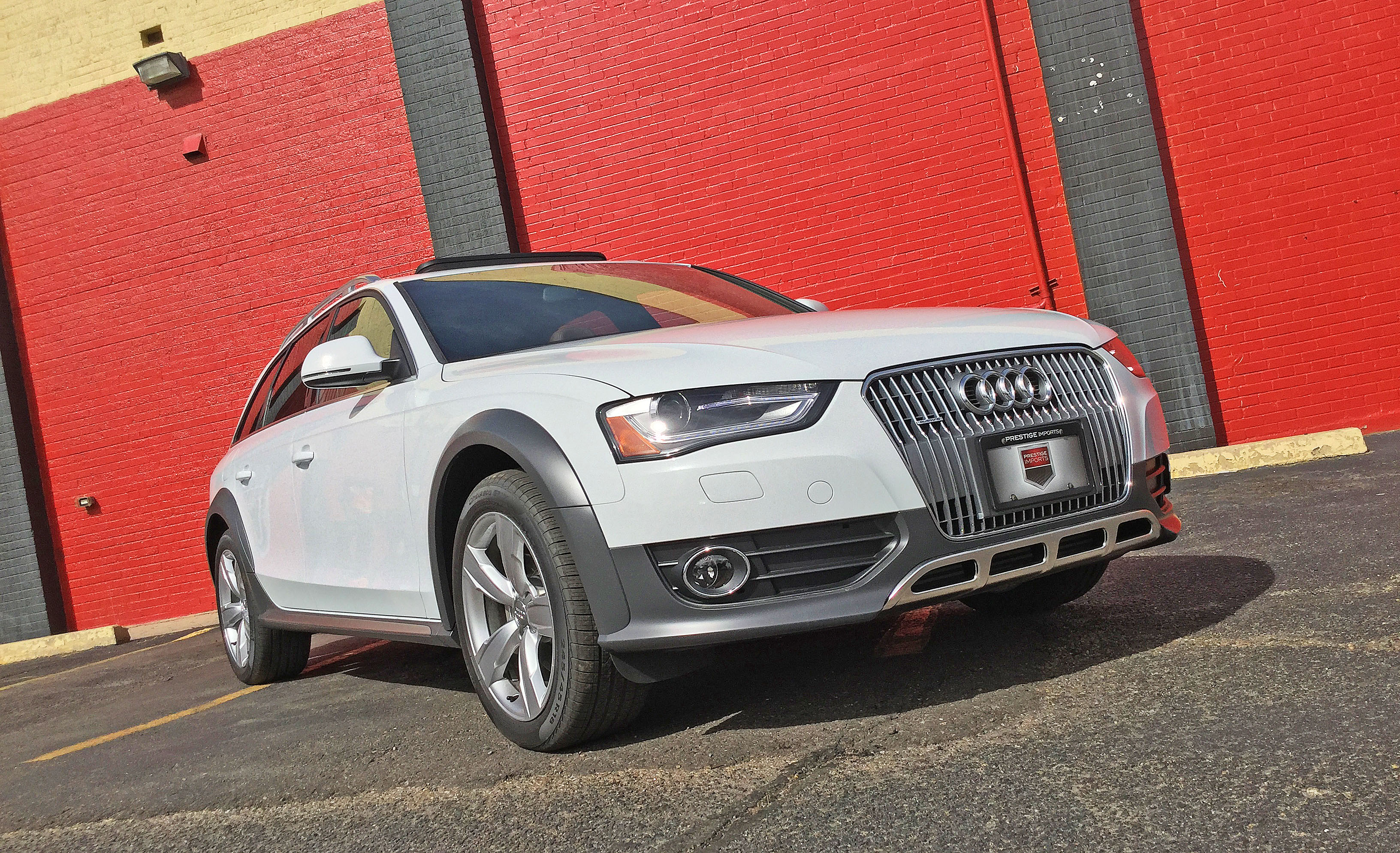 An Audi allroad sits in front of a colorful wall in Denver's Highlands neighborhood