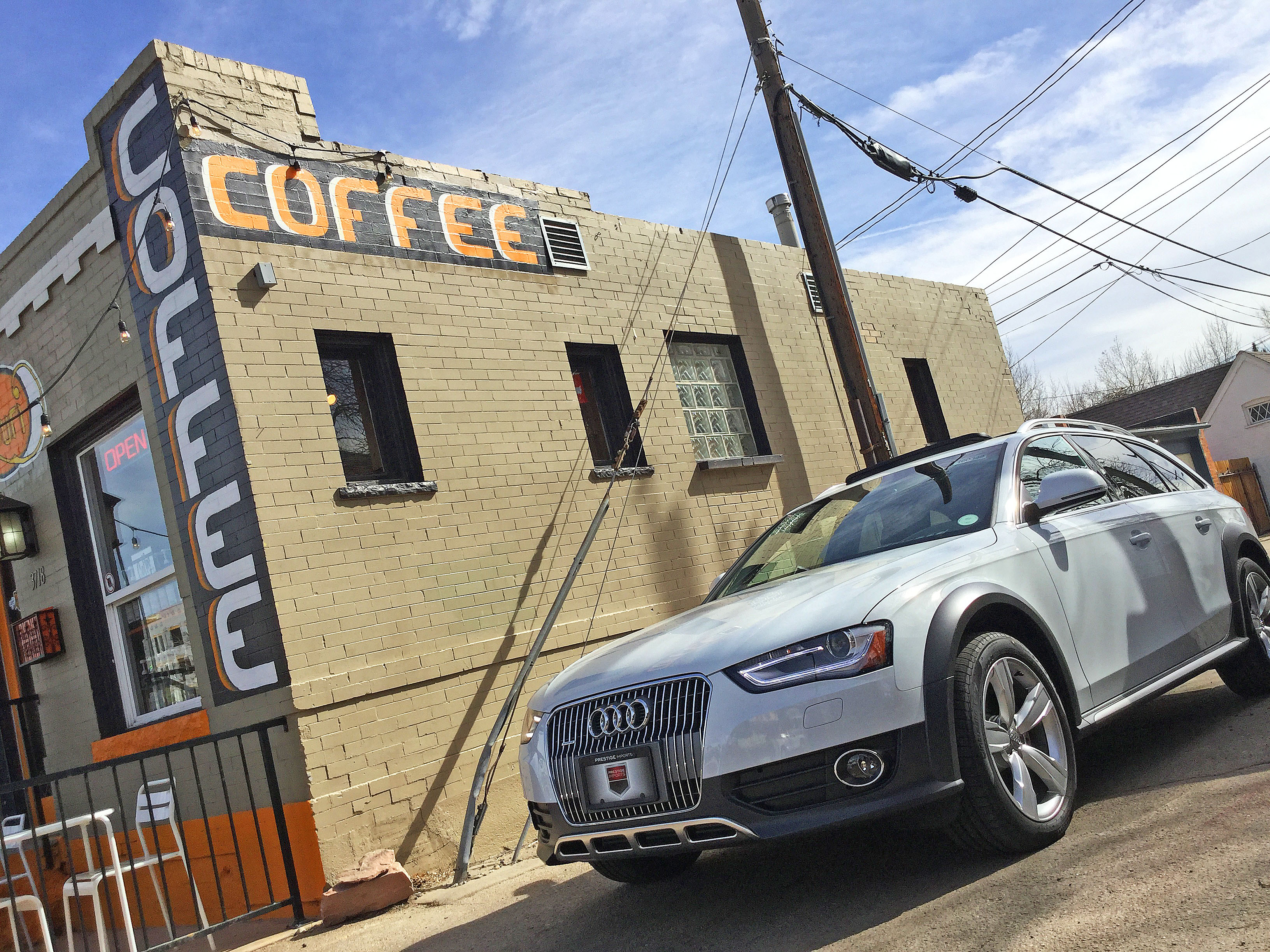 An Audi allroad parked next to a coffee shop in the Highlands, Denver, CO