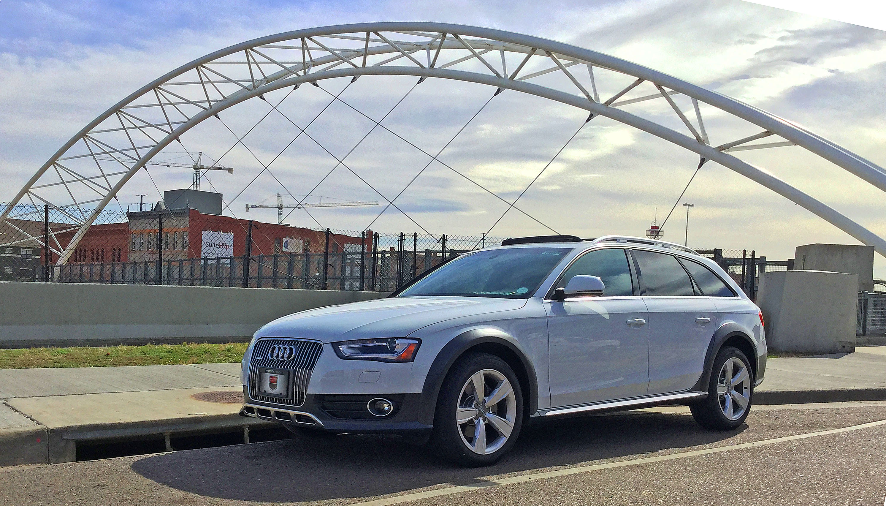 An Audi allroad sits in front of a pedistrian bridge in Denver's Highland Neighborhood