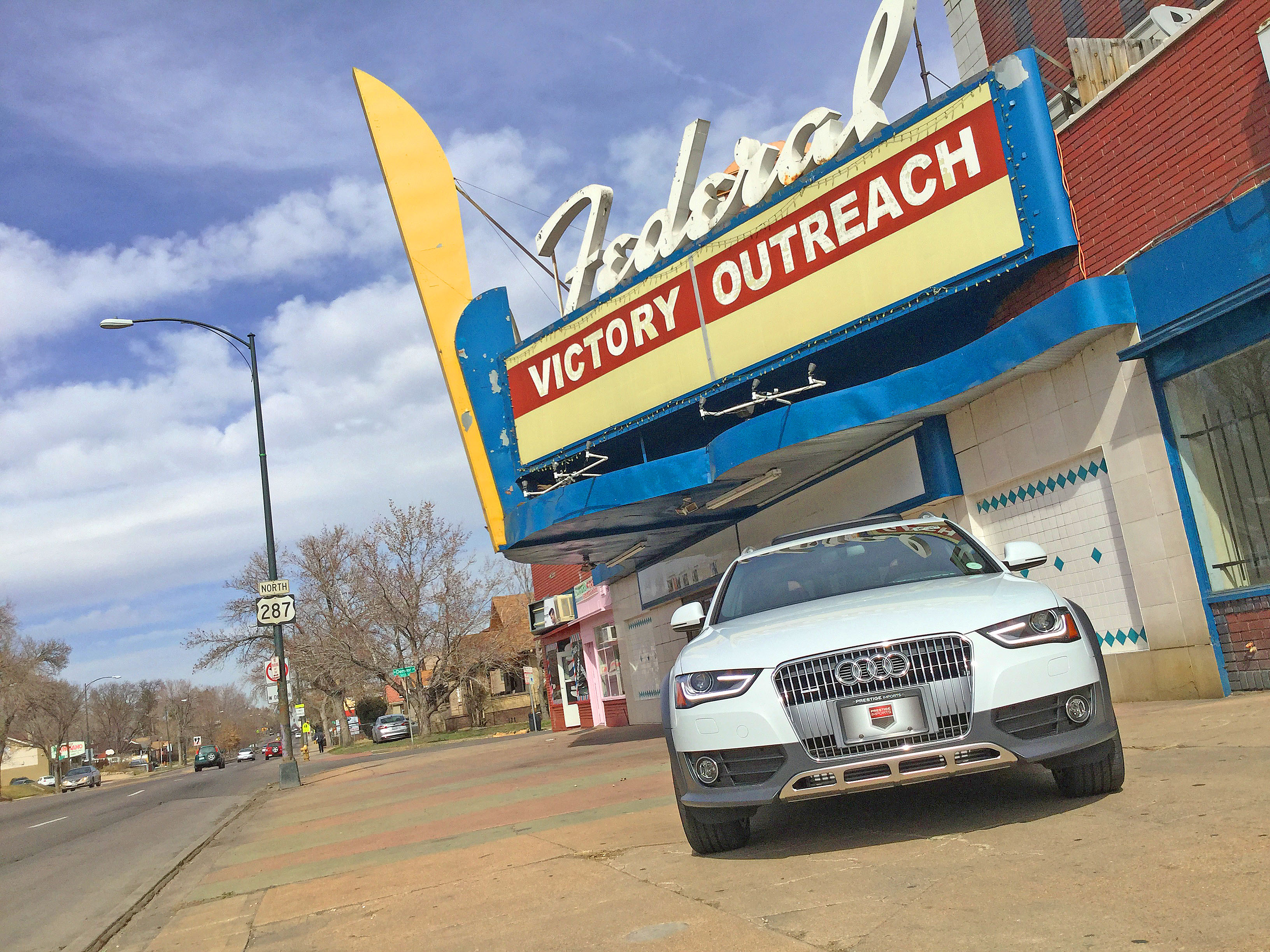 An Audi allroad sits in front of the Federal Victory Outreach Theater in the Highland area of Denver