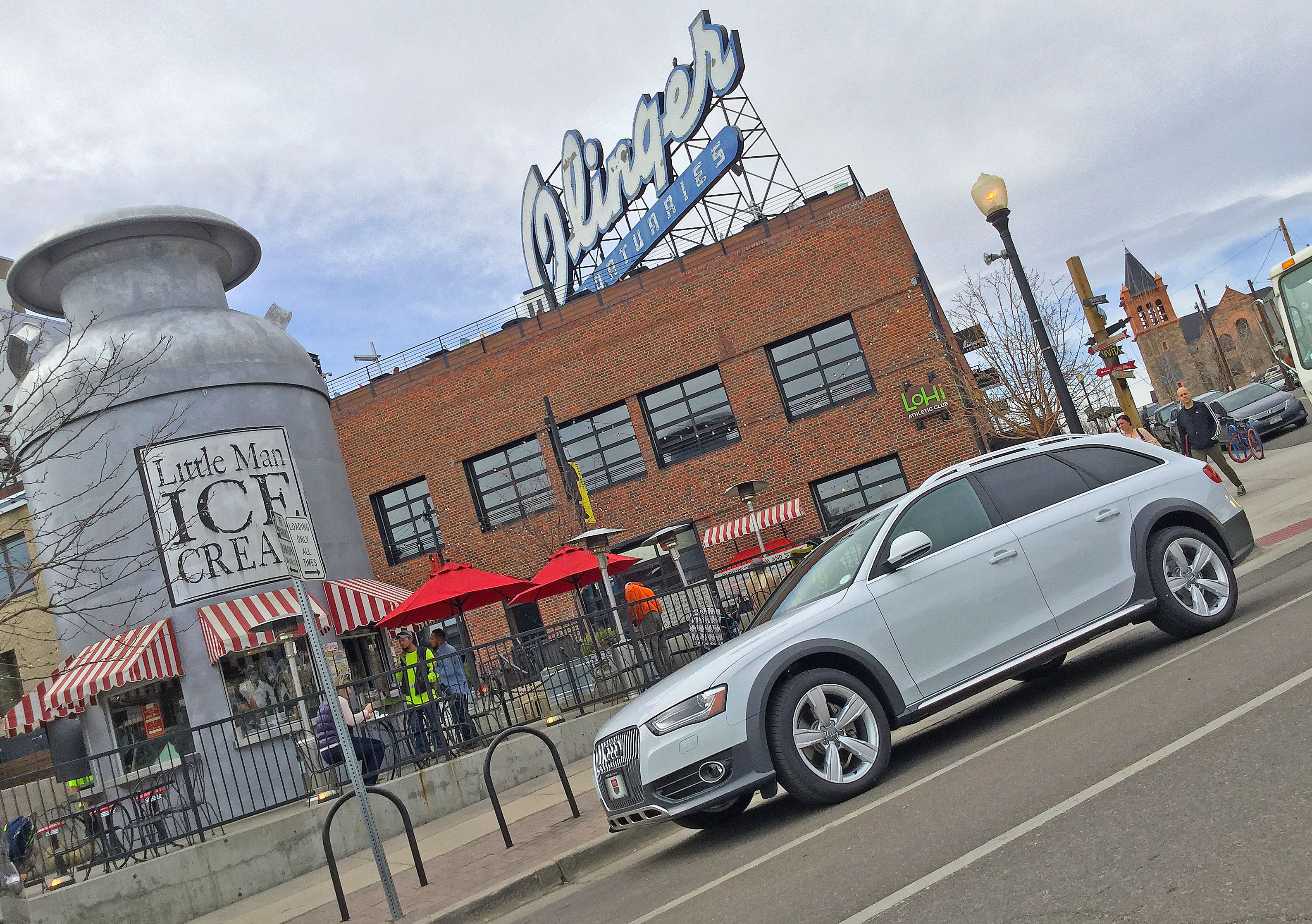 An Audi allroad parked in front of the old Olinger Mortuaries building in Denver's Highland neighborhood.