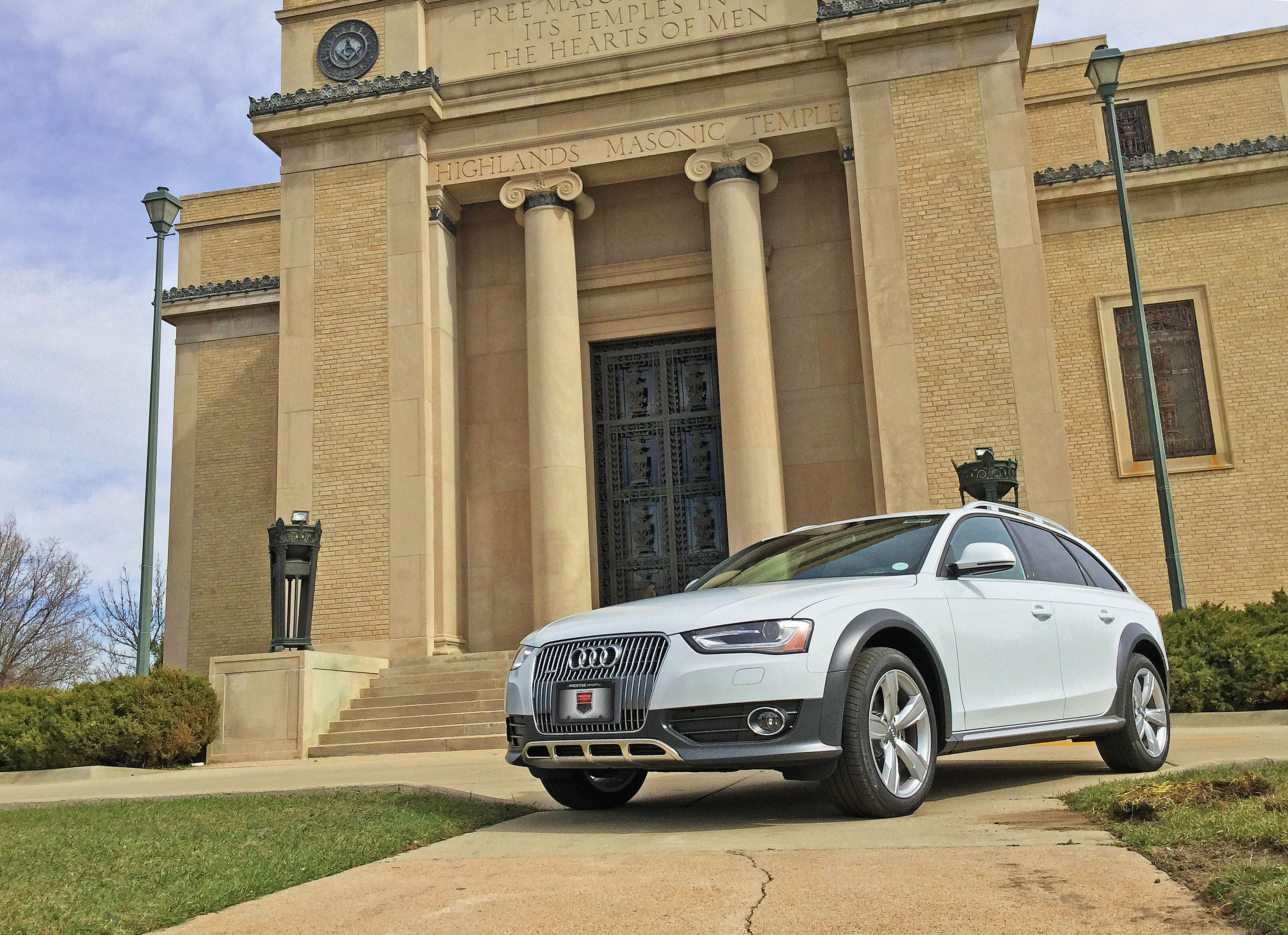 An Audi allroad parked in front of the Highlands Masonic Temple in Denver, CO