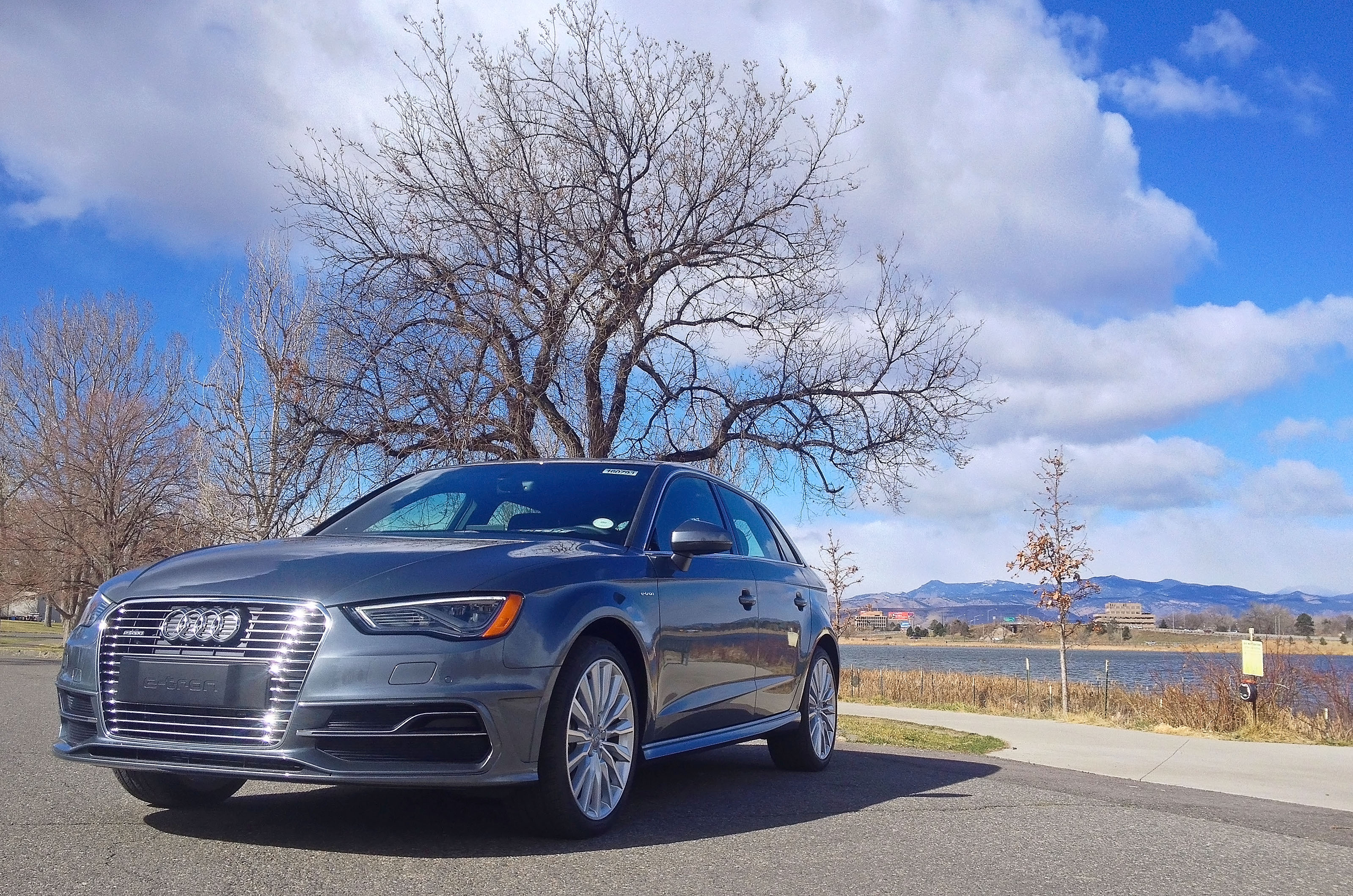 Audi A3 e-tron parked near Berkeley Lake in Denver, CO. The beautiful Rocky Mountains are visible in the background.
