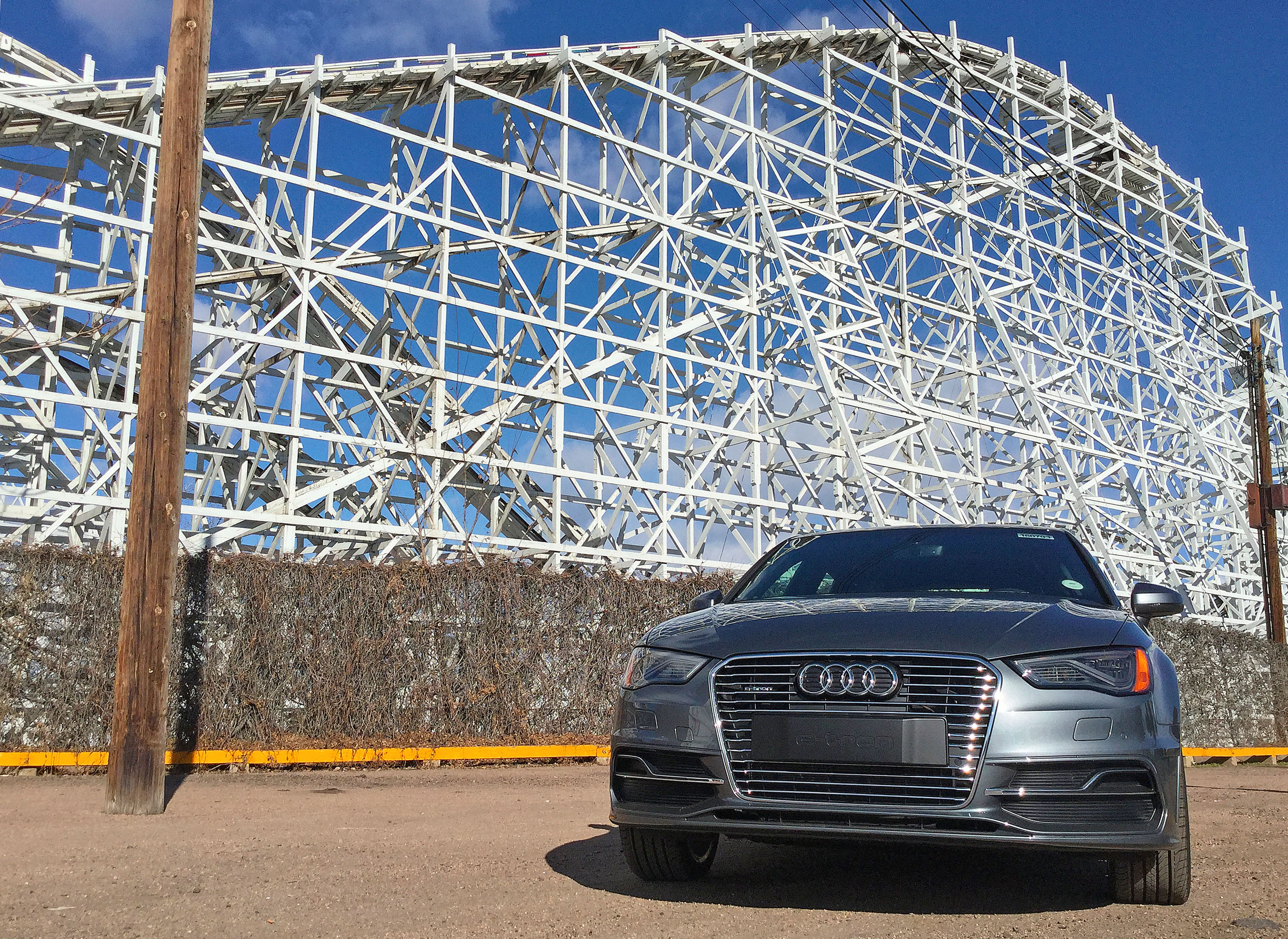 Audi A3 e-tron parked in front of the Cyclone Roller Coaster at Lakeside Amusement Park near Denver, CO.