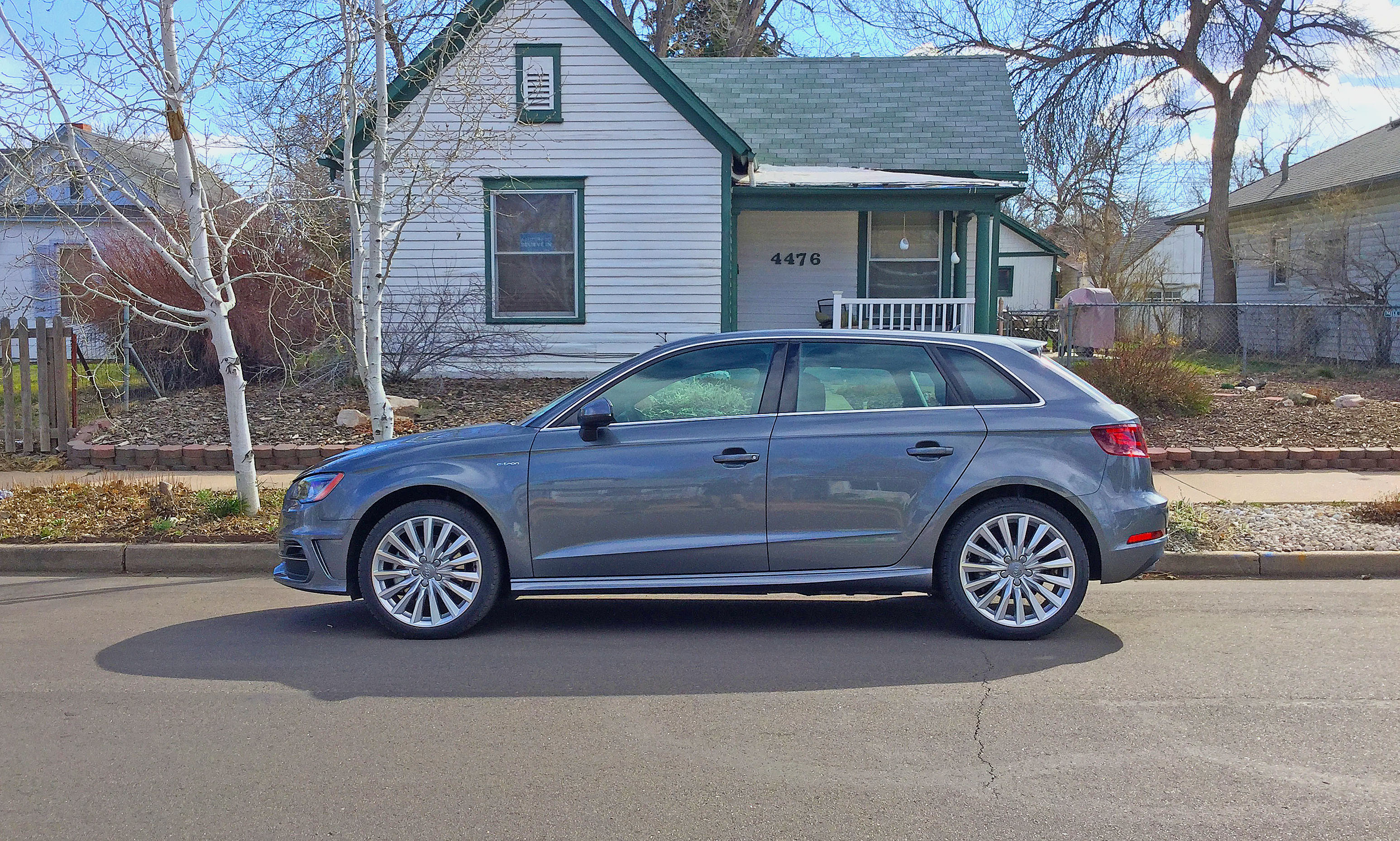 Audi A3 e-tron parked in front of a small cottage on Yates Street in Denver's Berkeley neighborhood.