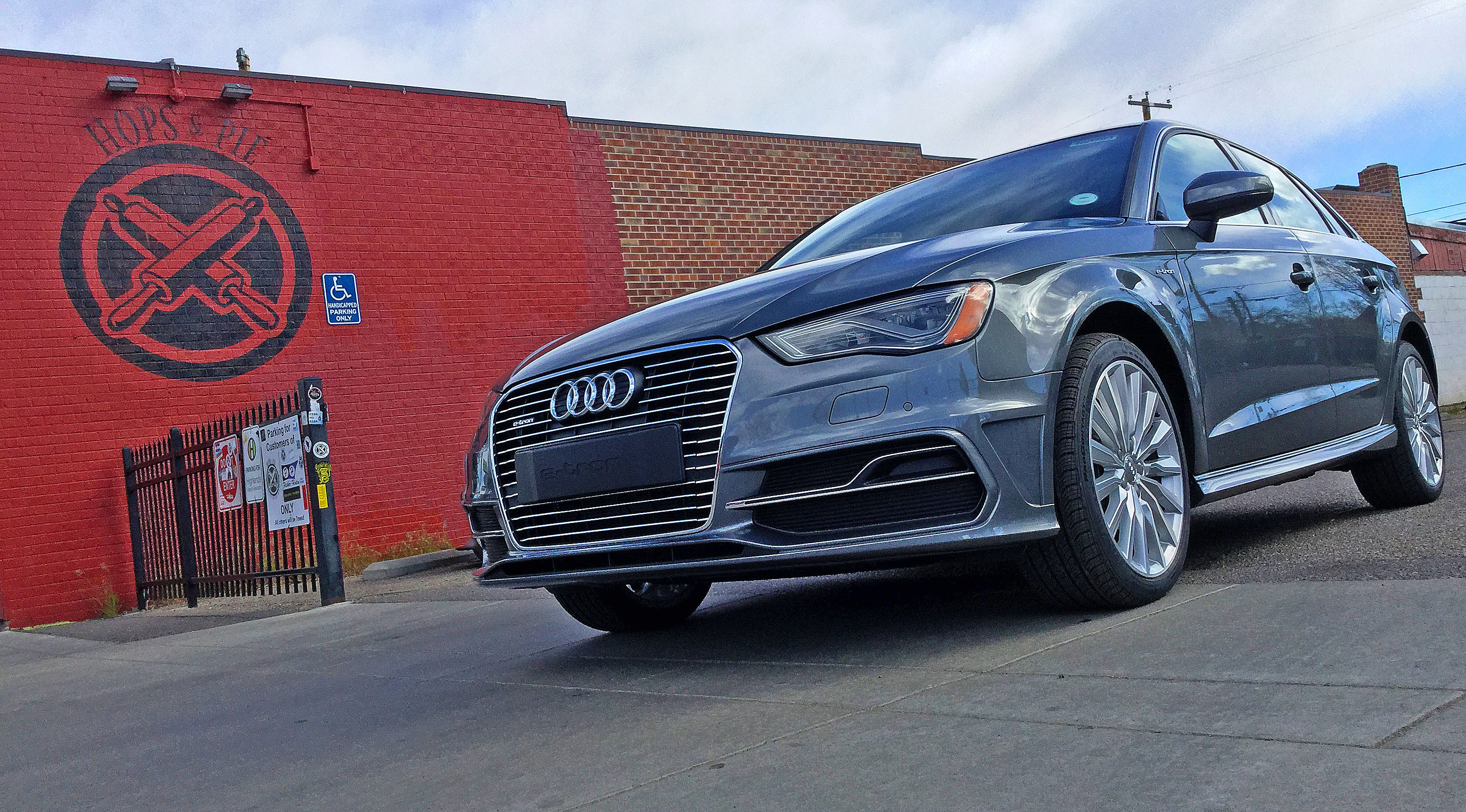 "Audi A3 e-tron parked near ""Hops & Pie"" a restaurant on Tennyson St. in the Berkeley area of Denver, CO."