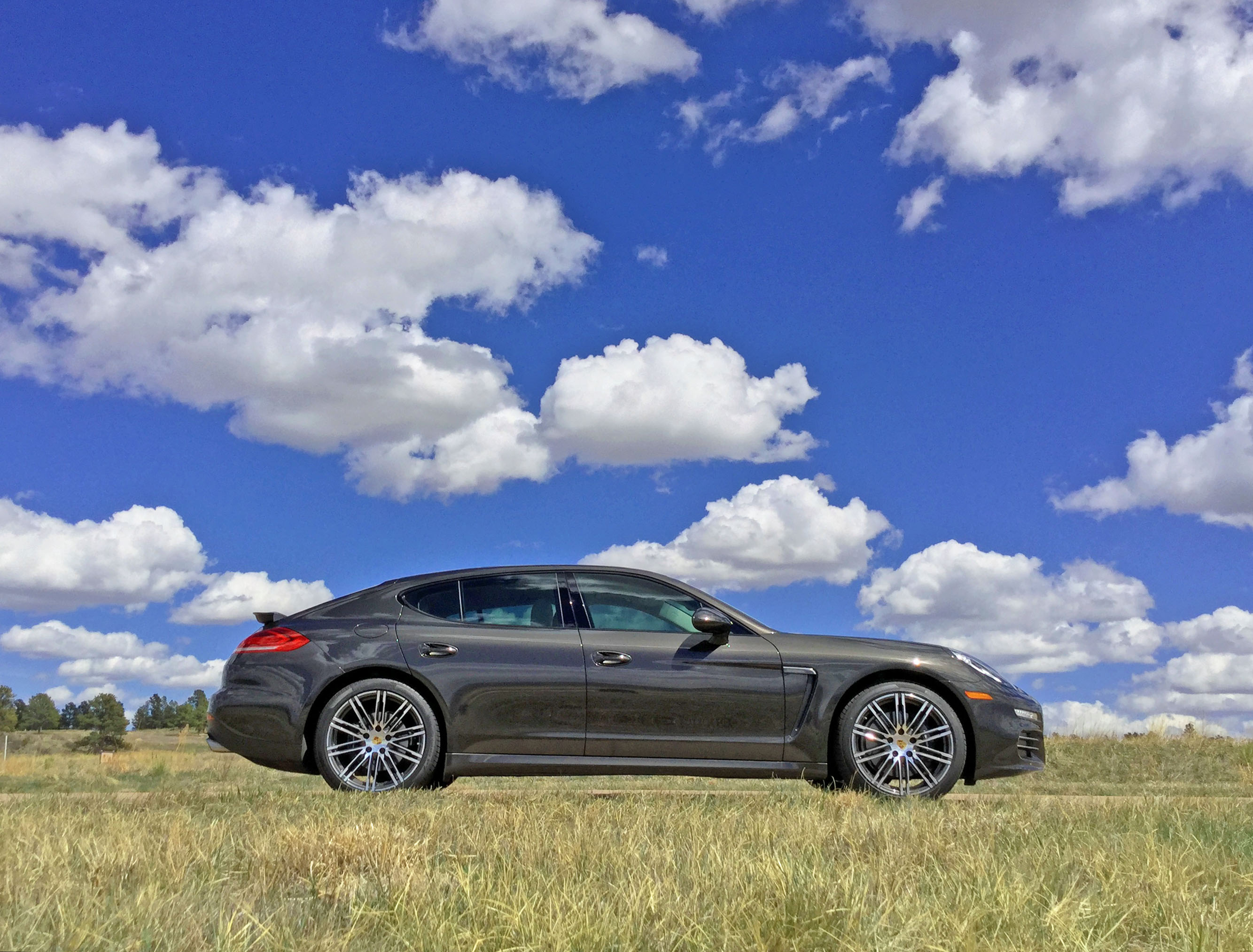 2016 Porsche Panamera 4 and puffy white clouds