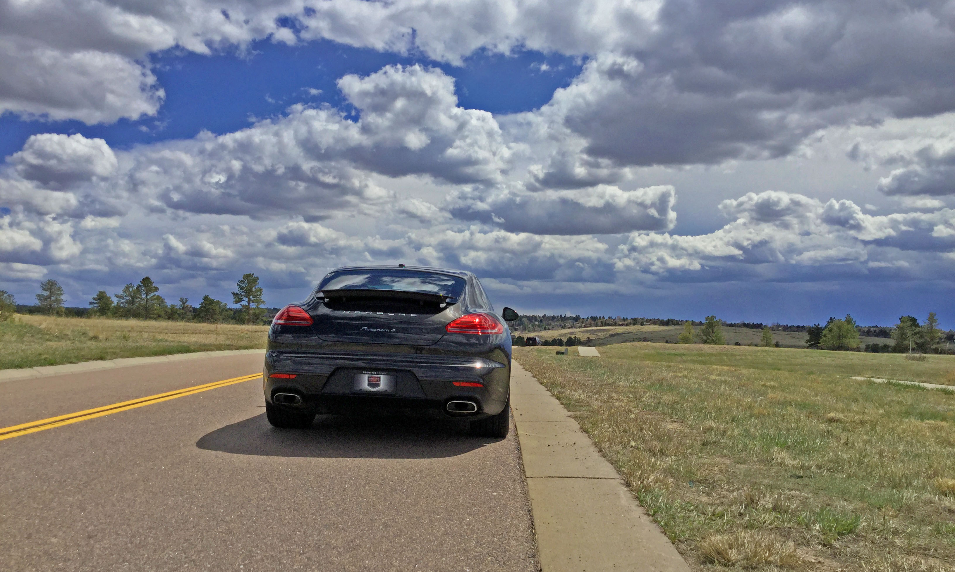 The 2016 Porsche Panamera 4 sits on a road near the Colorado Golf Club in Parker, CO