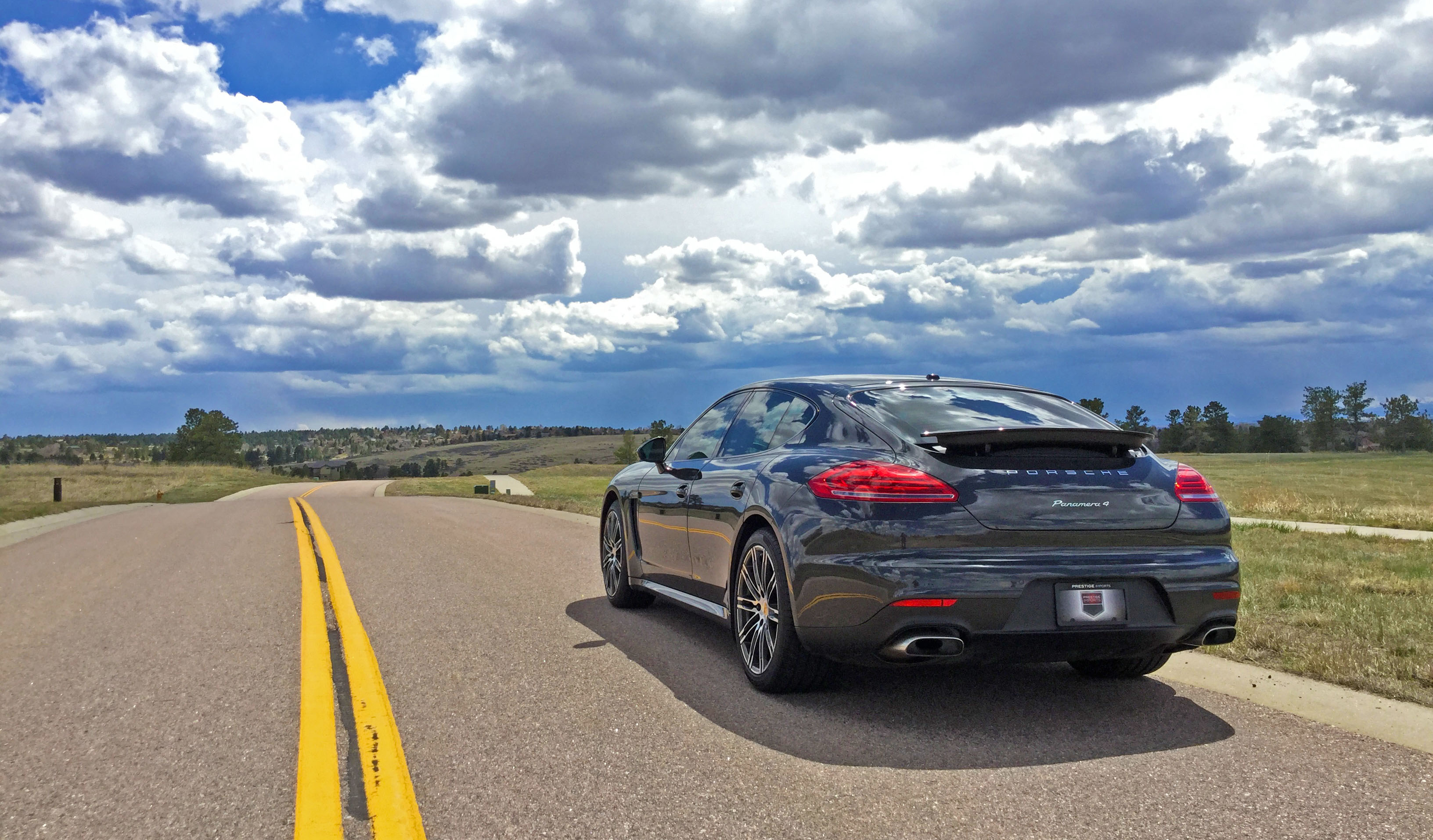 2016 Porsche Panamera 4 and rainstorm in the distance