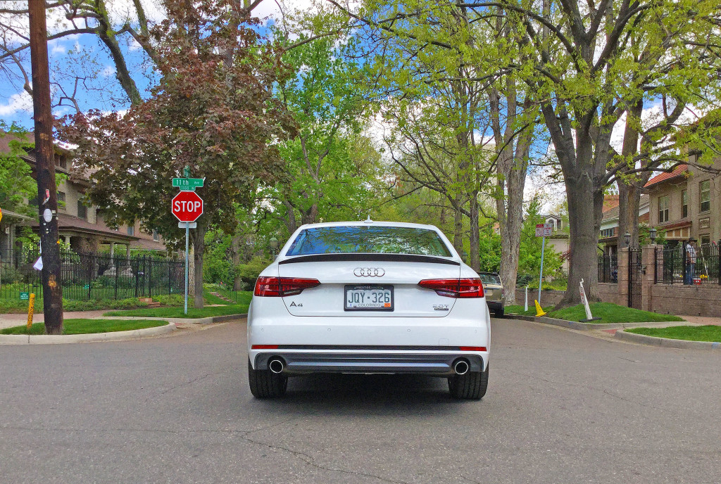 The all new 2017 Audi A4 on a tree lined street in Denver's Cheesman Park neighborhood