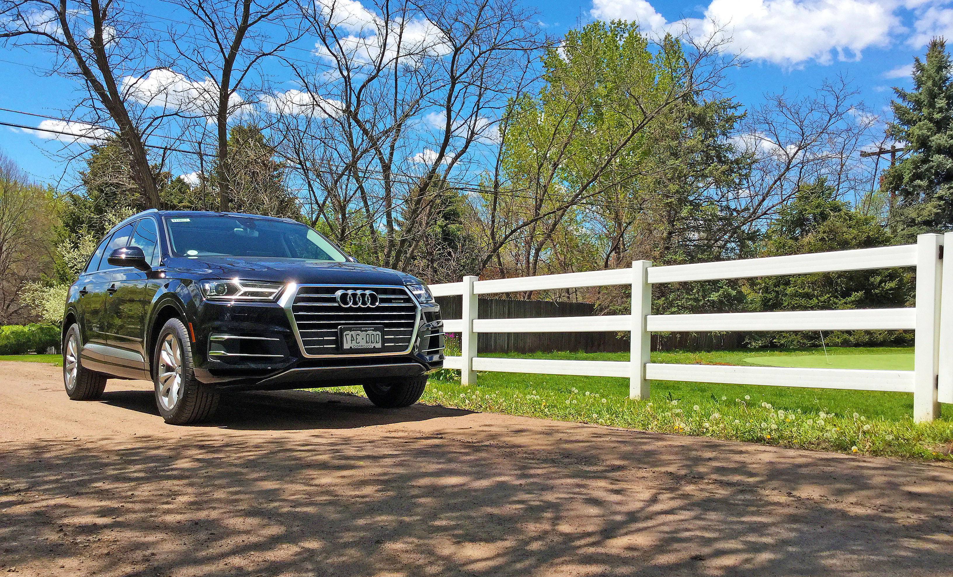 The Audi Q7 parked along a white fence on Radcliff Avenue in Cherry Hills  Village,