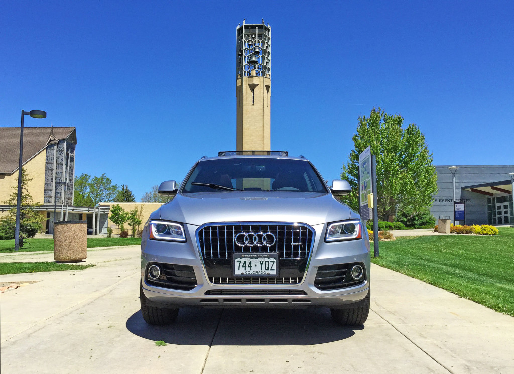 An Audi Q5 parked in front of Olinger Tower at Johnson and Wales University in Denver's South Park Hill Neighborhood