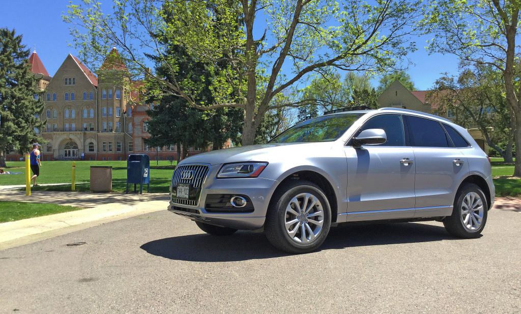 An Audi Q5 foregrounded against the historic Treat Hall at Johnson and Wales University in Denver's South Park Hill Neighborhood