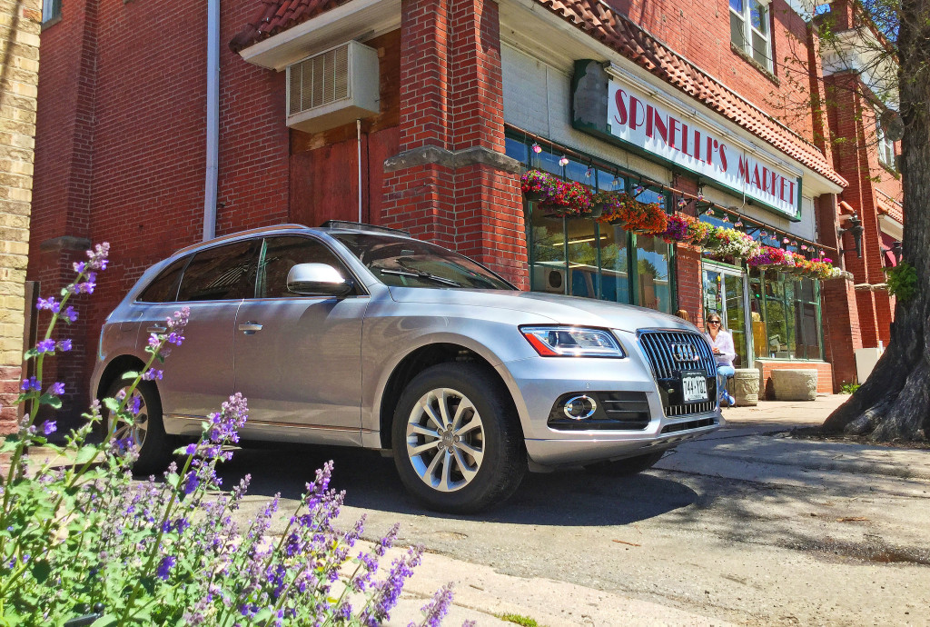 The Audi Q5 and blooming flowers outside of Spinelll's Italian Market in Denver's South Park Hill Neighborhood