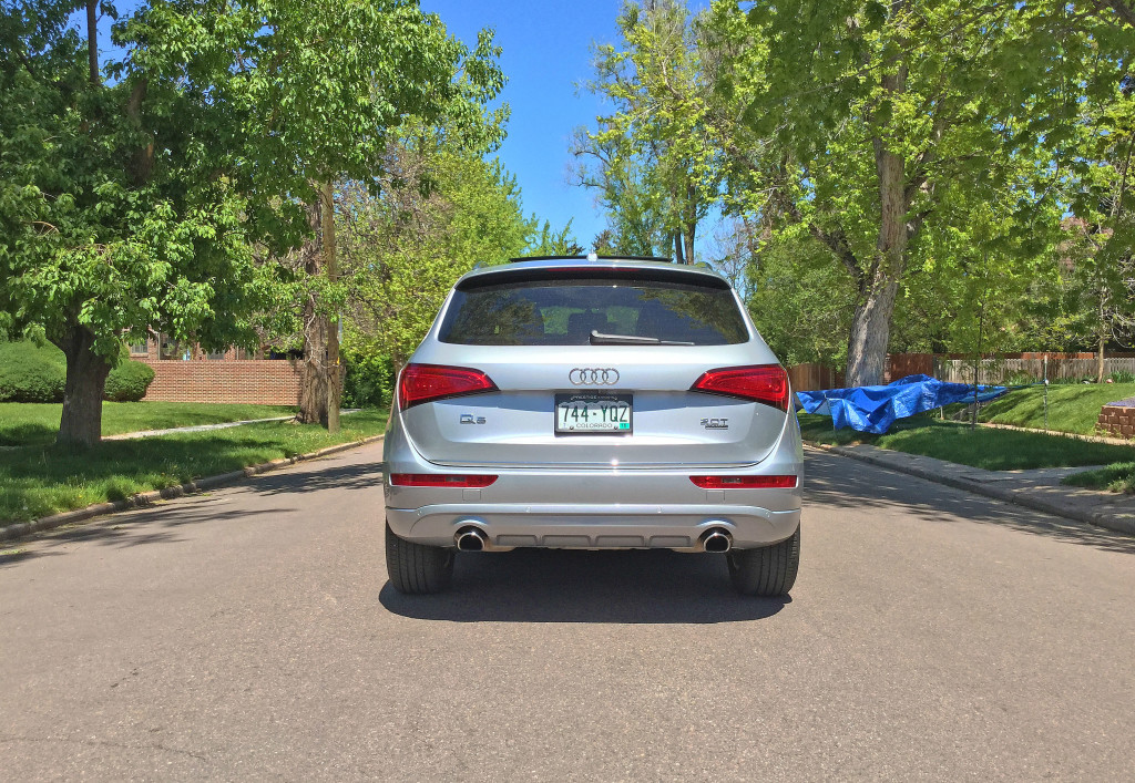 The rear view of an Audi Q5 on a tree -lined street in Denver's South Park Hill Neighborhood